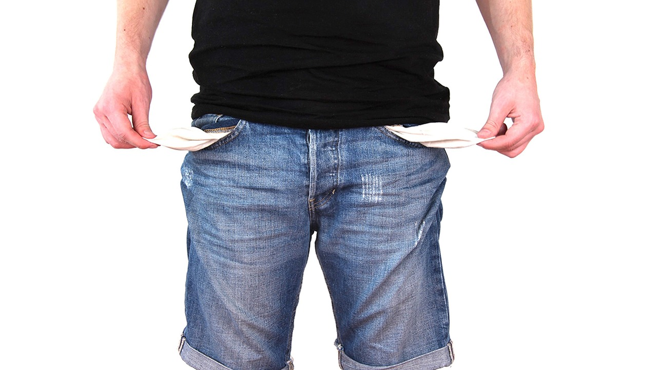 man turning out empty pockets