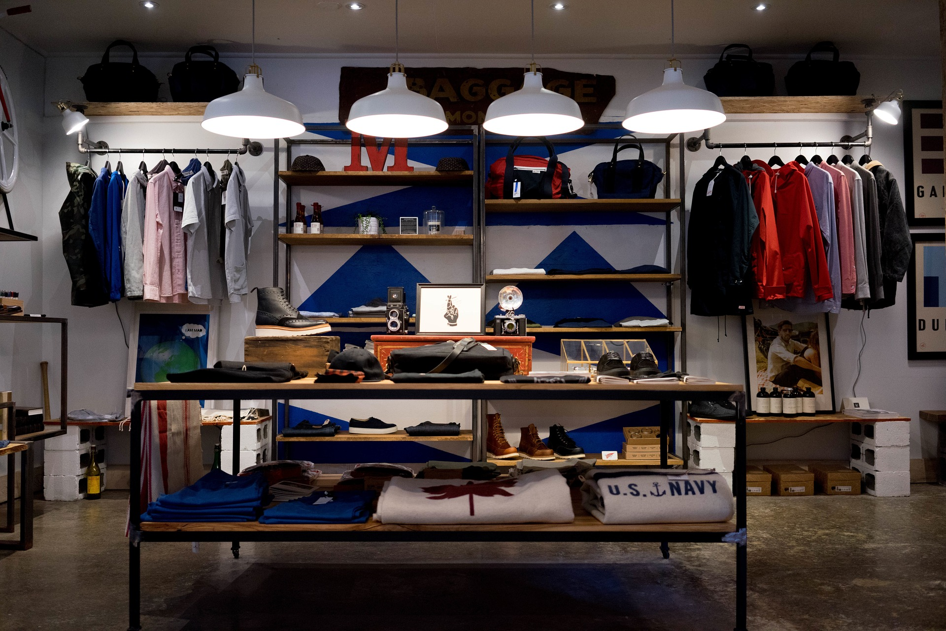 shelves with clothing and dim lighting